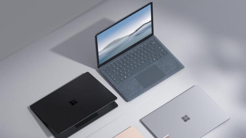 dua-len-ban-can-surface-laptop-4-va-macbook-air-m12